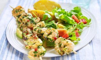 Lime chilli and coriander prawn skewers with avocado salad