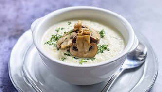 Keto Ready Cauliflower Soup topped with Mushrooms
