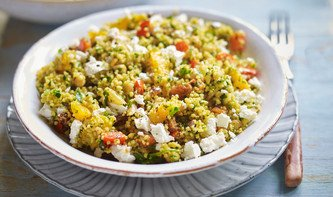 Moroccan vegetable couscous salad with orange and raisins